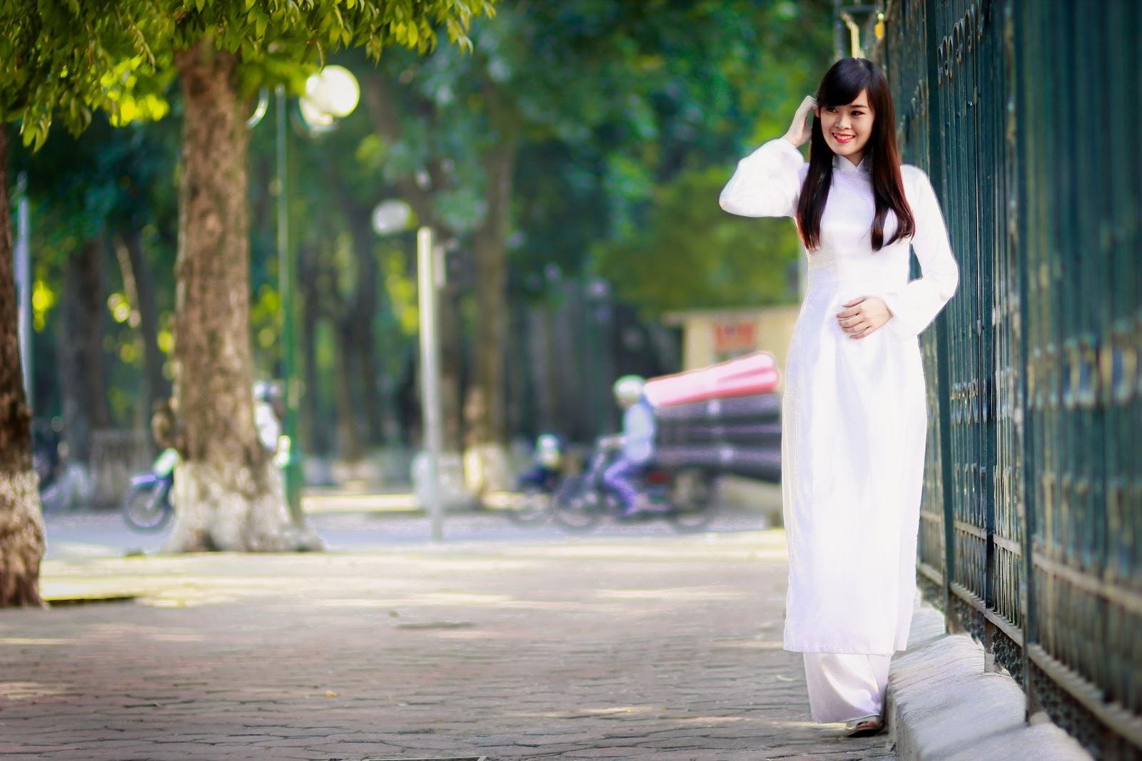 Các cách tạo dáng đẹp khi chụp ảnh với áo dài tôn vinh