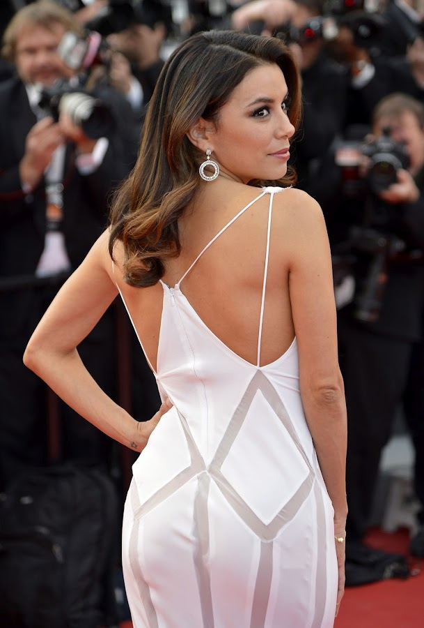 EVA LONGORIA poses for paparazzi at Cannes Film Festival red carpet 2012