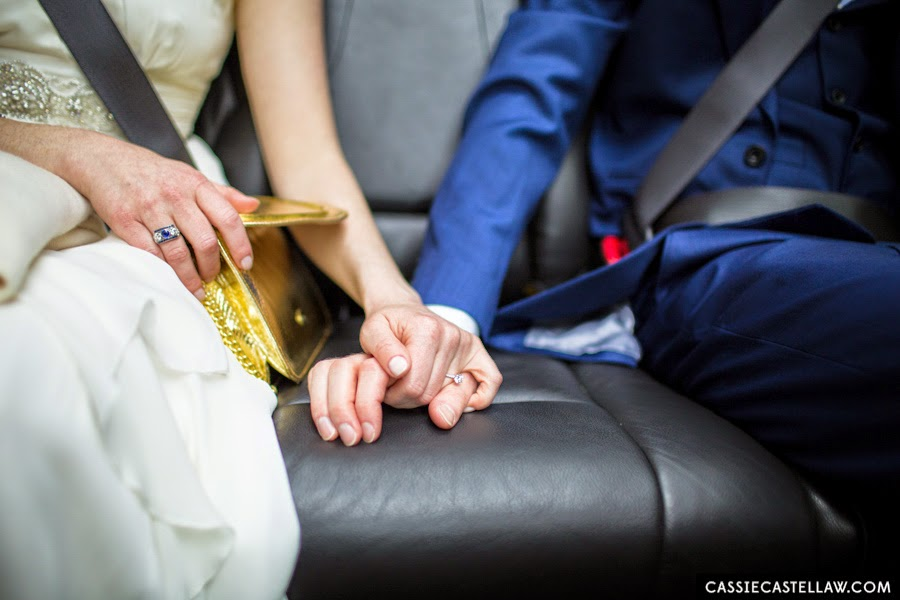 Something blue: vintage three-stone diamond and sapphire ring. Candid of bride and groom holding hands in the car on the way to their wedding. NYC Lifestyle wedding photography by Cassie Castellaw. www.cassiecastellaw.com