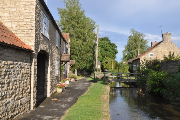 Morgan's Milieu | Home Exchange Membership Giveaway: Photo of a house beside the canal
