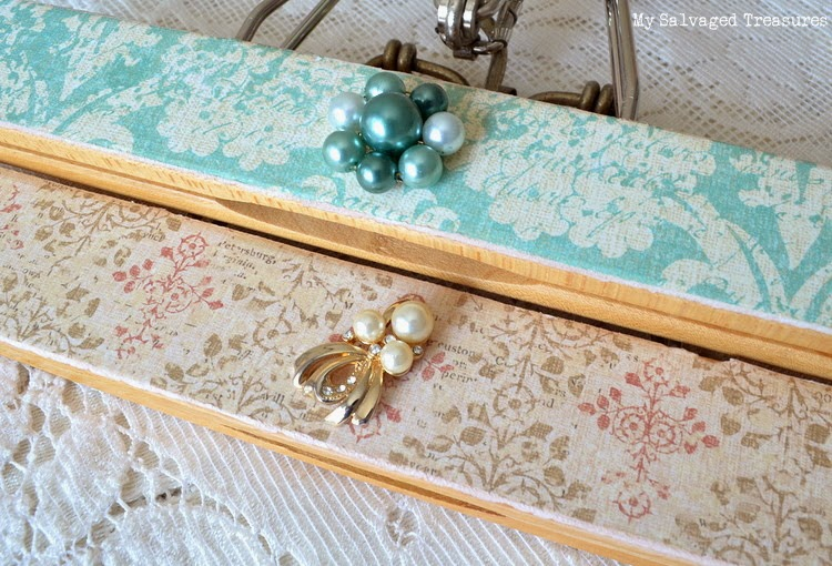 hangers decorated with vintage earrings and craft paper