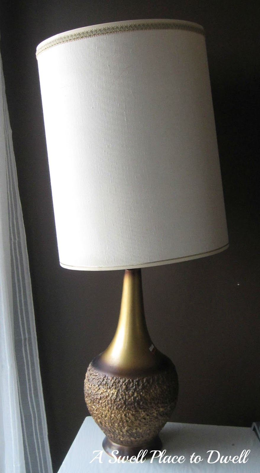 A swell place to dwell thats one funky lamp remember my mad men lamp i bought this bad boy at the salvation army for 9 it was that over sized shade that called my name and wouldnt let me go home aloadofball Images