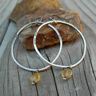 http://www.artandsouljewelry.com/products/large-fine-silver-hoops-citrine-sun-goddess