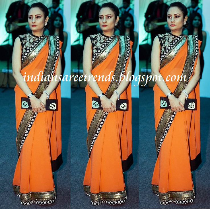 Color georgette sari with designer black border paired with designer