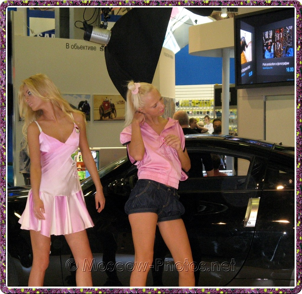 Blonde models in pink next to the car at Photoforum - 2008