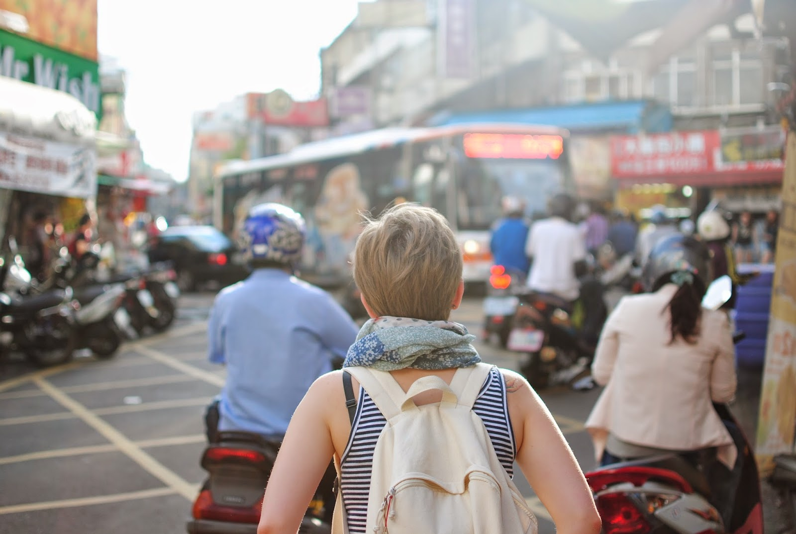 Woman traveling with backpack via unsplash credit  Steven Lewis - Hello, Handbag