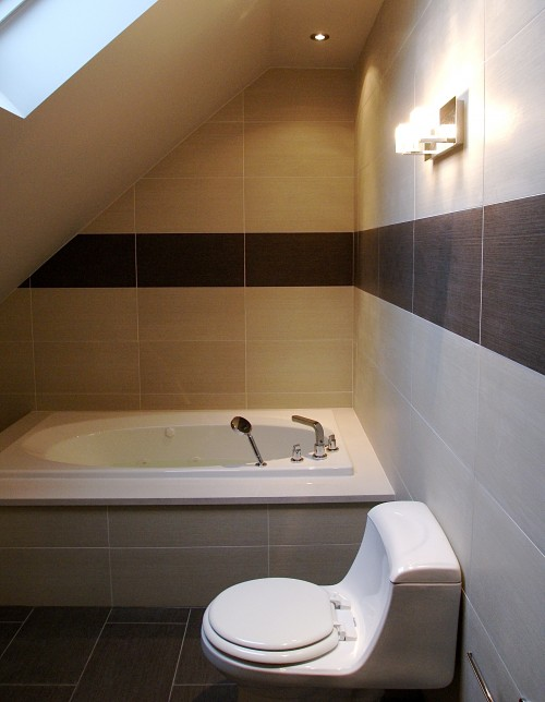 Attic works attic bathrooms for Small bathroom with sloped ceiling