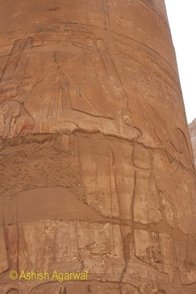 Broken carvings on the pillar of the Hypostyle Hall in the Karnak temple