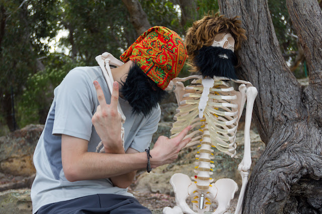 skeleton and man with beard imitating gangsters