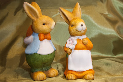 2 little brown ceramic rabbits