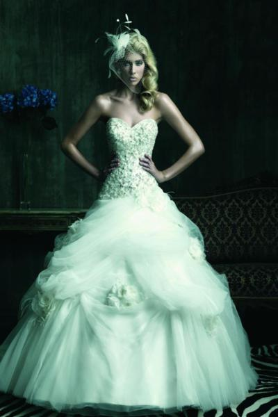 A ball gown wedding dress is the most formal gown a Bride can wear and it's