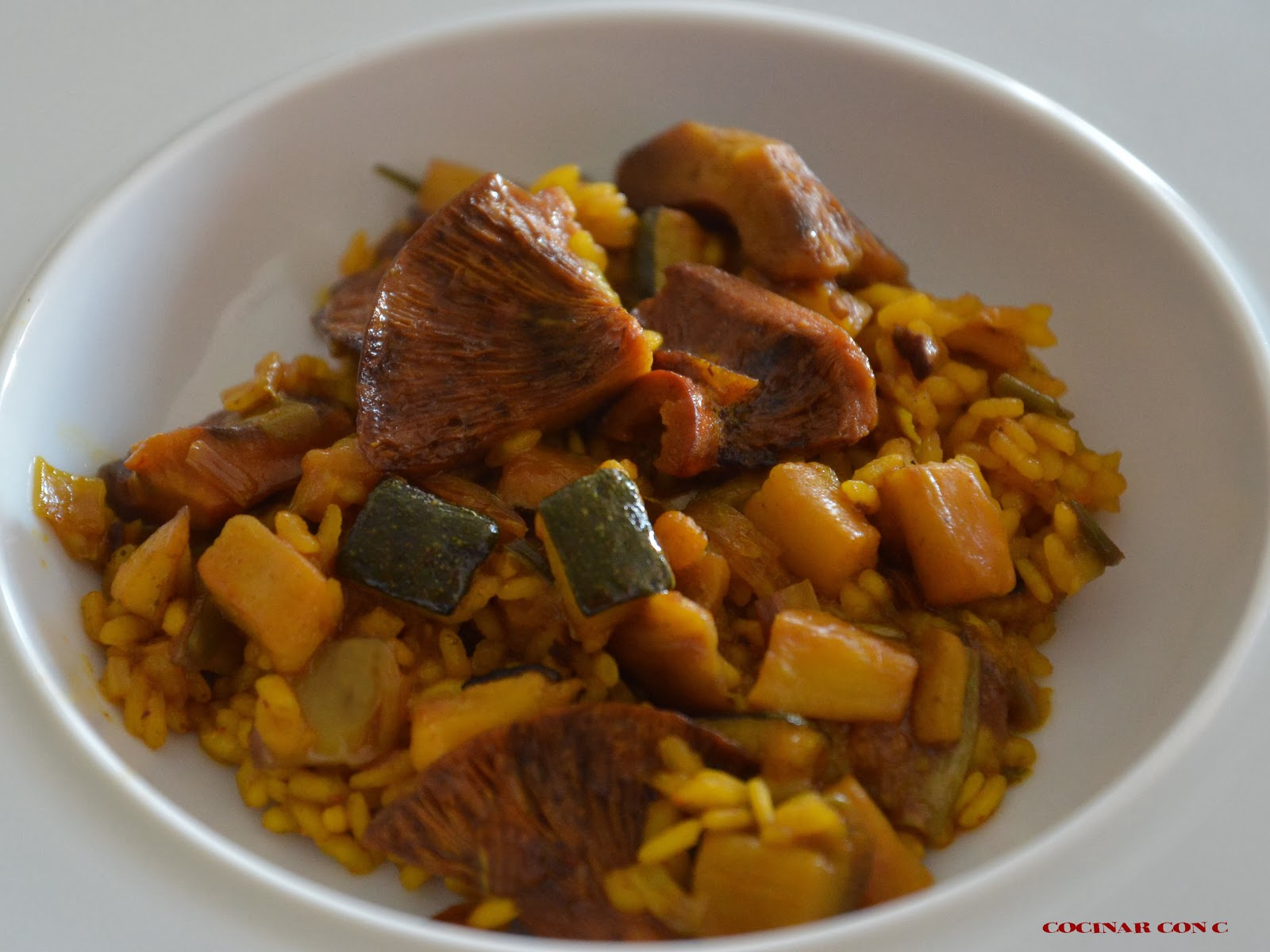 cocinar con c arroz meloso con sepia verduras y
