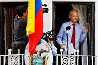 Julian Assange takes aim at US as diplomatic row deepens; Speech from balcony calls on Obama to abandon witchhunt