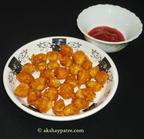 Sevre baby corn pakoda with tomato ketchup or chutney.