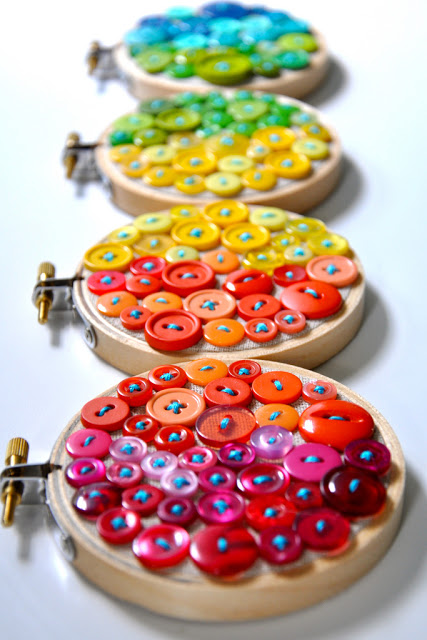 this embroidery hoop art project is made with colorful buttons - great for some bright decorations
