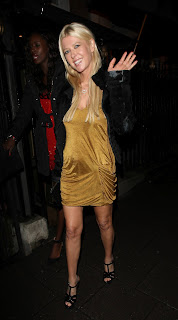 Tara Reid  waves to cameras as she leaves Annabel's Club in London