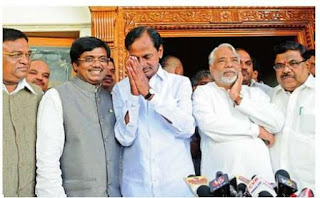TRS Chief K. Chandrasekhar Rao gestures as congress MPS