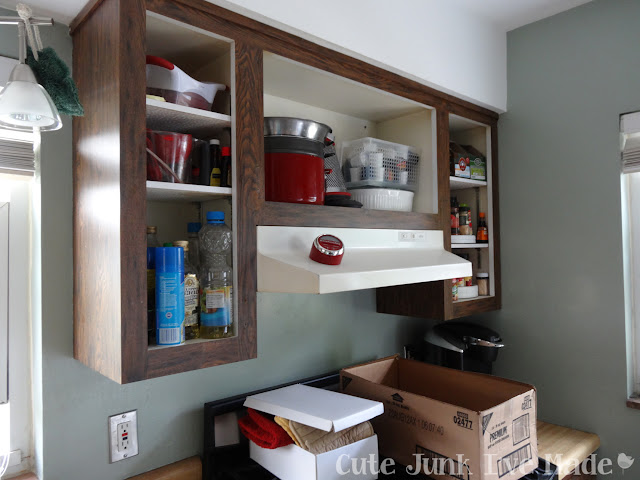 Laminate cabinets with doors removed, stuff still inside