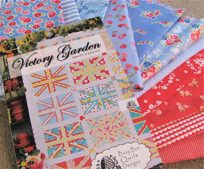 Victory Garden Quilt Pattern with red and blue fabrics