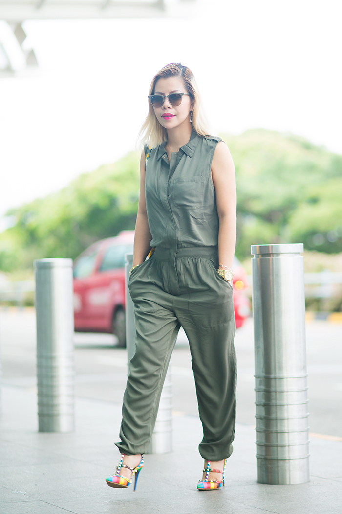 Crystal Phuong wore Forever21 army green jumpsuit and Valentino Multi colors rockstud heels