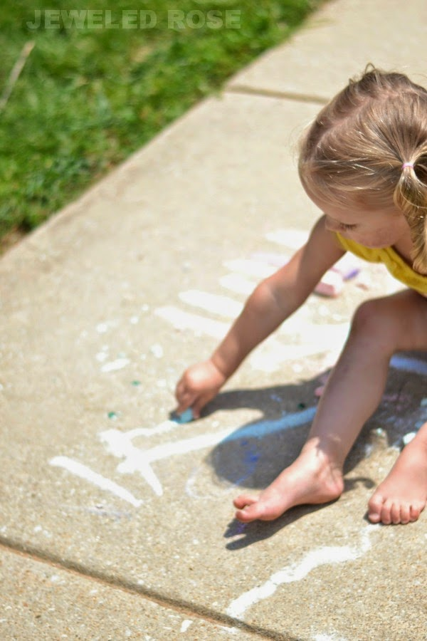 Easy to make sidewalk chalk with treasures hidden inside; how fun!