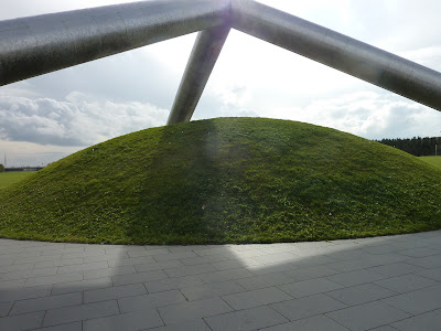 Tetra Mound at Moerenuma Koen (Moerenuma Park), Sapporo. There are three big metal columns that meet above a mound of grass