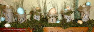 Burlap wrapped toilet paper rolls holding eggs for Spring Arrangement at One More Time Events.com
