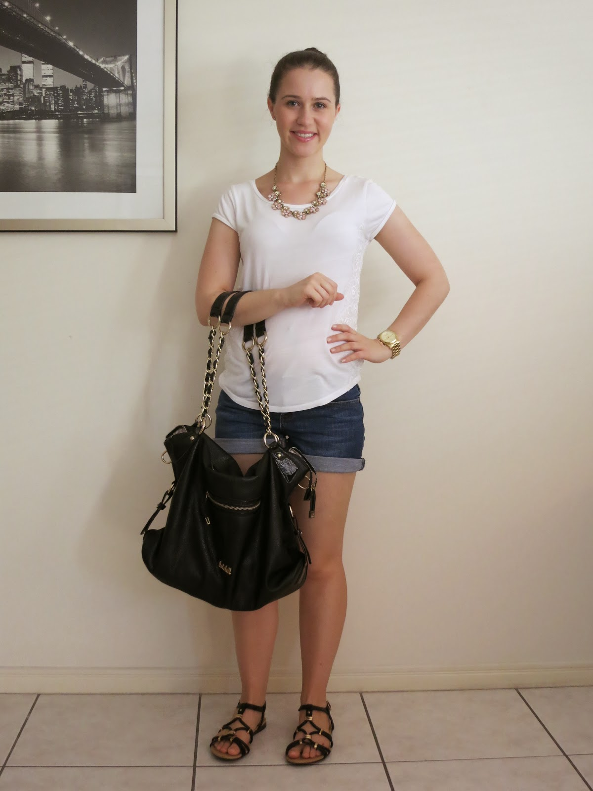 petite girl outfit, everyday outfit, petite outfit, dark wash denim shorts, t-shirt, denim shorts and t-shirt, gold jewellery, black and gold bag and sandals