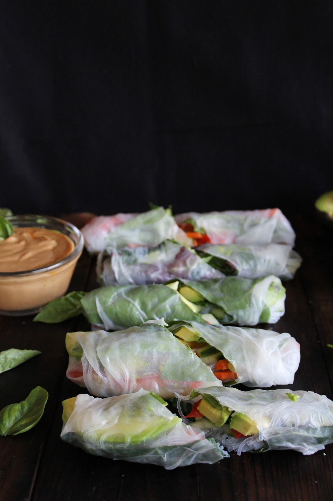 ... summer rolls with basil, avocado, kale + spicy garlic peanut sauce