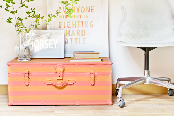 coral and orange painted striped trunk