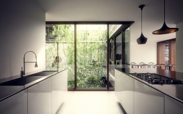 rumah modern dengan dinding batu alam rancangan desain