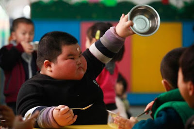 fat asian boy wants more food