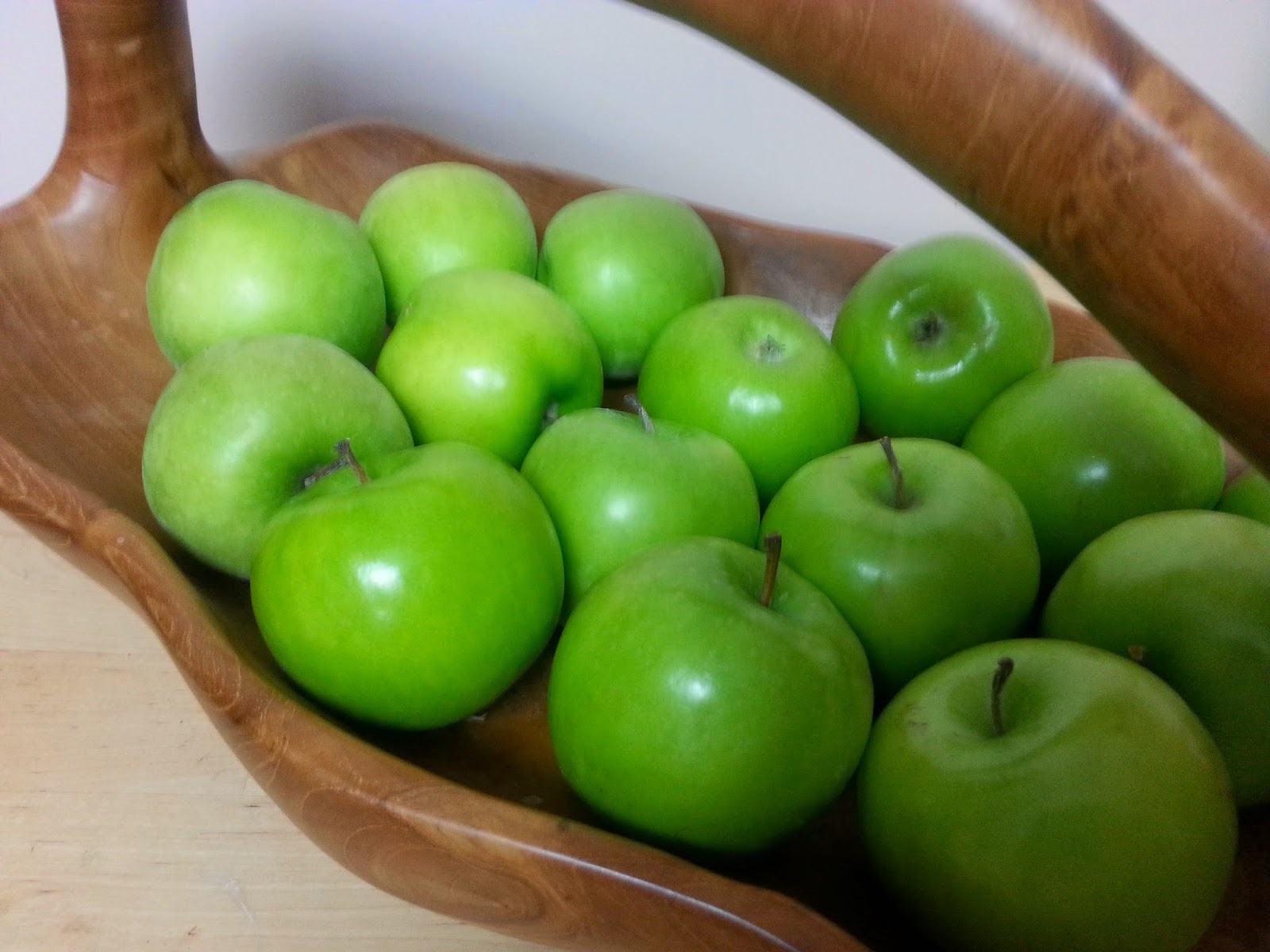 Green apples in basket