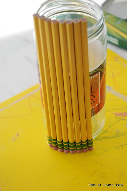 glueing on pencils for a pencil vase