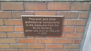 Plaque explaining old Burke building features remaining