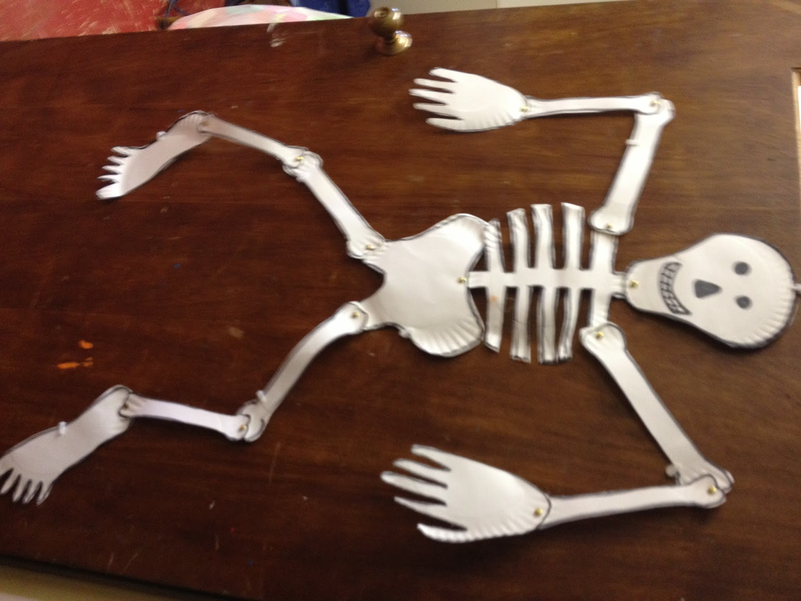 Mrs goffs pre k tales lots of halloween craft ideas skeleton made from paper plates and brads jeuxipadfo Image collections