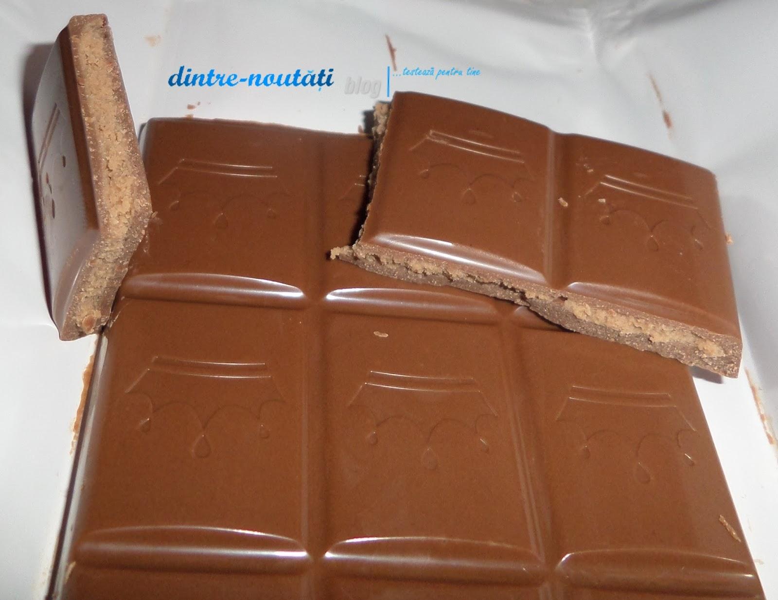Ciocolată cu lapte umplută cu cremă (36%) de lapte și alune
