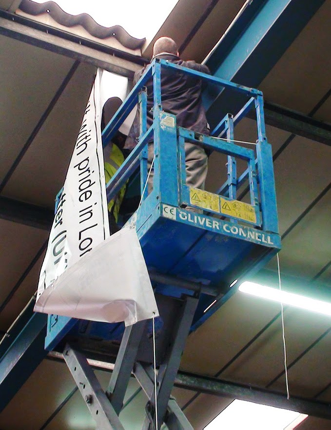 Simon Densley putting up the new banner