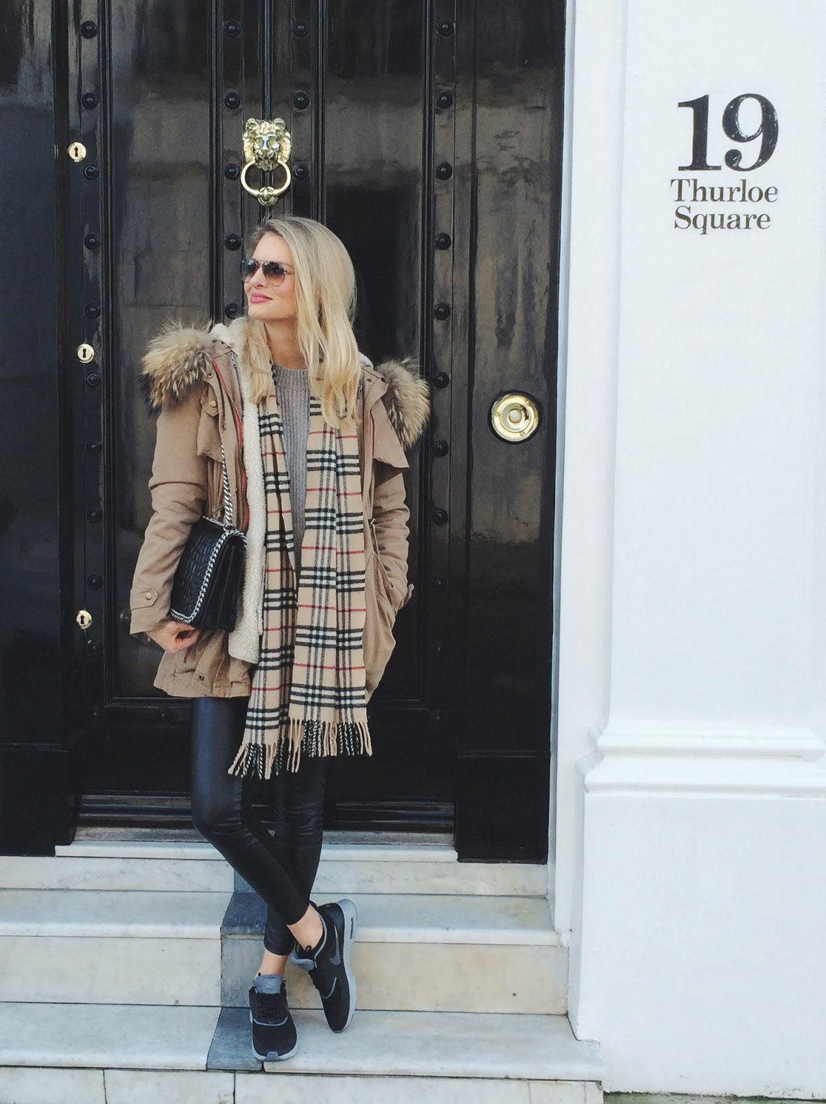 london blogger, minusey parka, minusey racoon parka, camel parka, leather leggings and nike trainers, nike trainers street style, ray ban glasses, ray ban sunglasses, parka with shearling