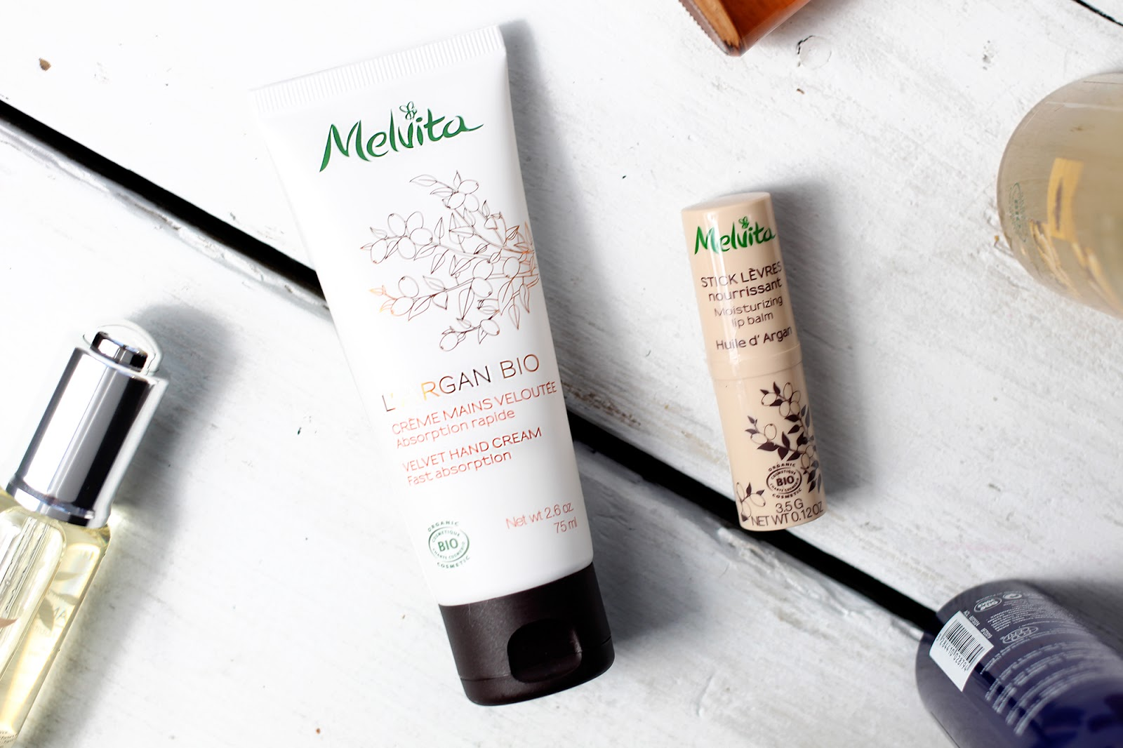 A beauty blogger reviews various products from organic skincare brand Melvita
