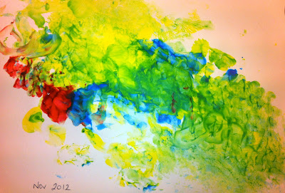 his first masterpiece - blue yellow red and green splodges