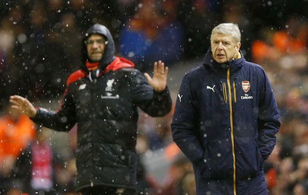 Bosses: Klopp and Wenger look on at Anfield