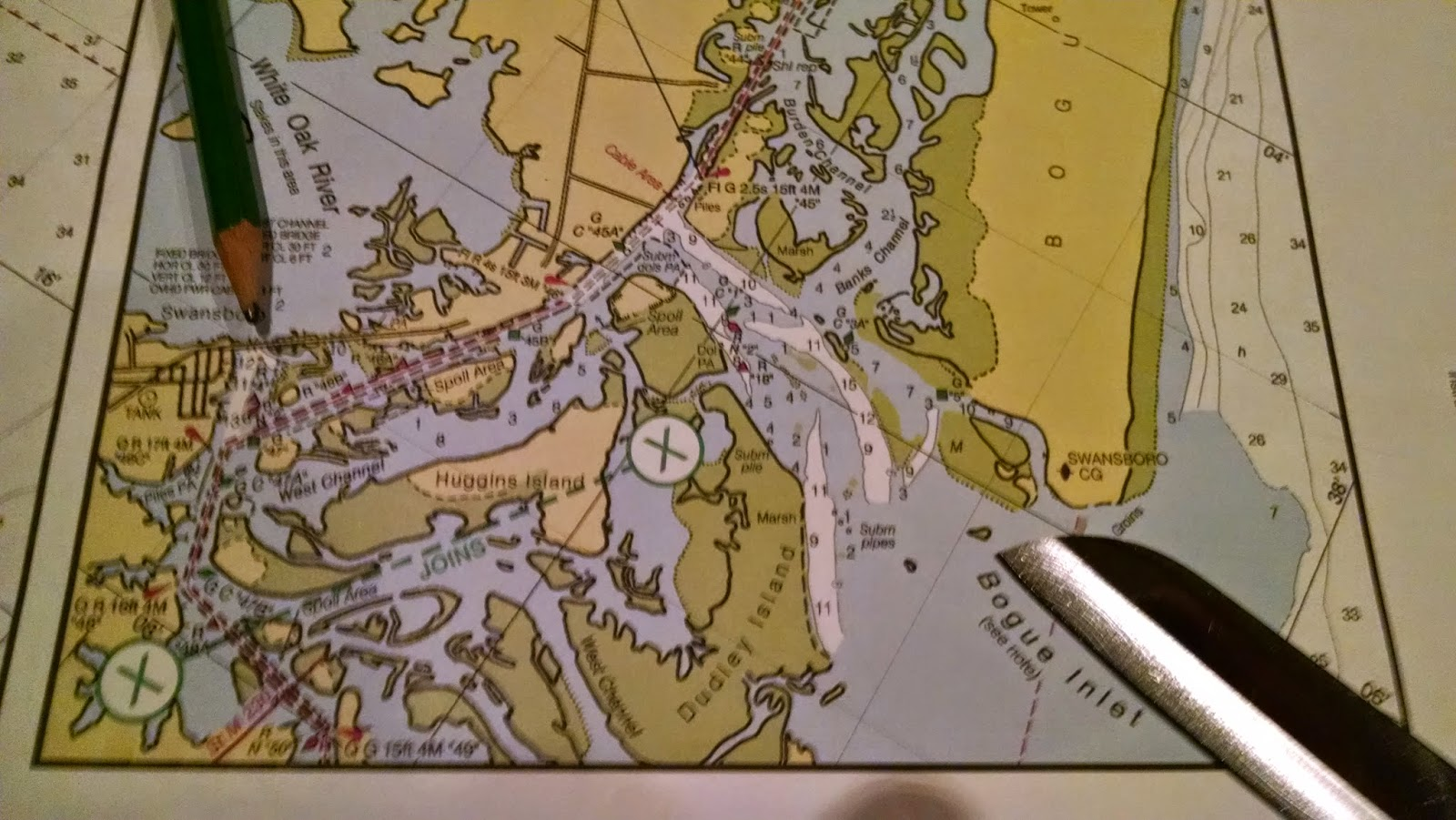 Ilene the boat november 7 morehead city to swansboro 204 miles the pencil is pointing to the white spot to the right of the town where we are anchored in the lower left just below the line x x is a magenta line nvjuhfo Images