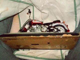 Mattel Barbie Harley Davidson motorcycle on a pillow.