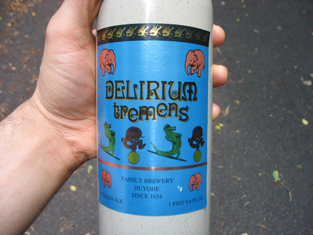 Holding a bottle of Delirium Tremens