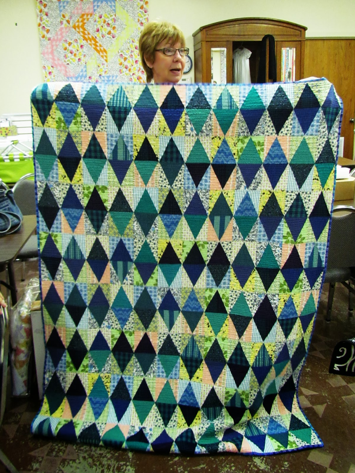 vintage feed sacks in equalateral triangle quilt by Marty Mason