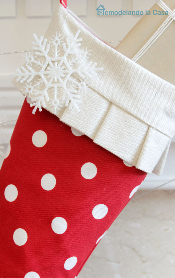red and white mantel with snow flake art