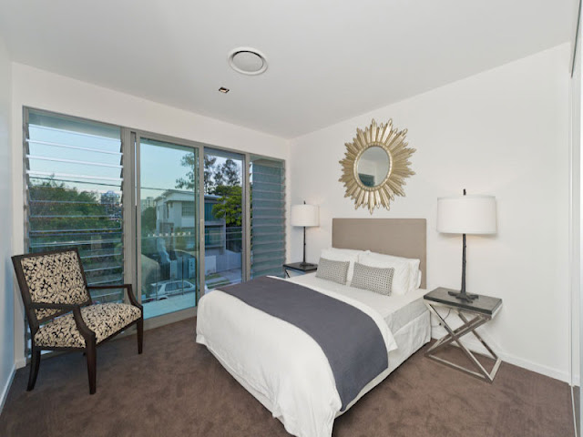 Photo of modern bed in smaller bedroom of contemporary home in Brisbane
