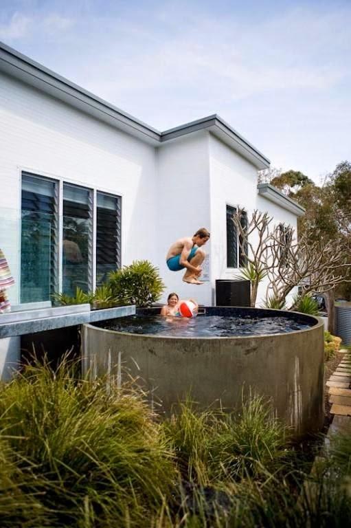 La maison boheme stock tank pool for Concrete stock tank swimming pool
