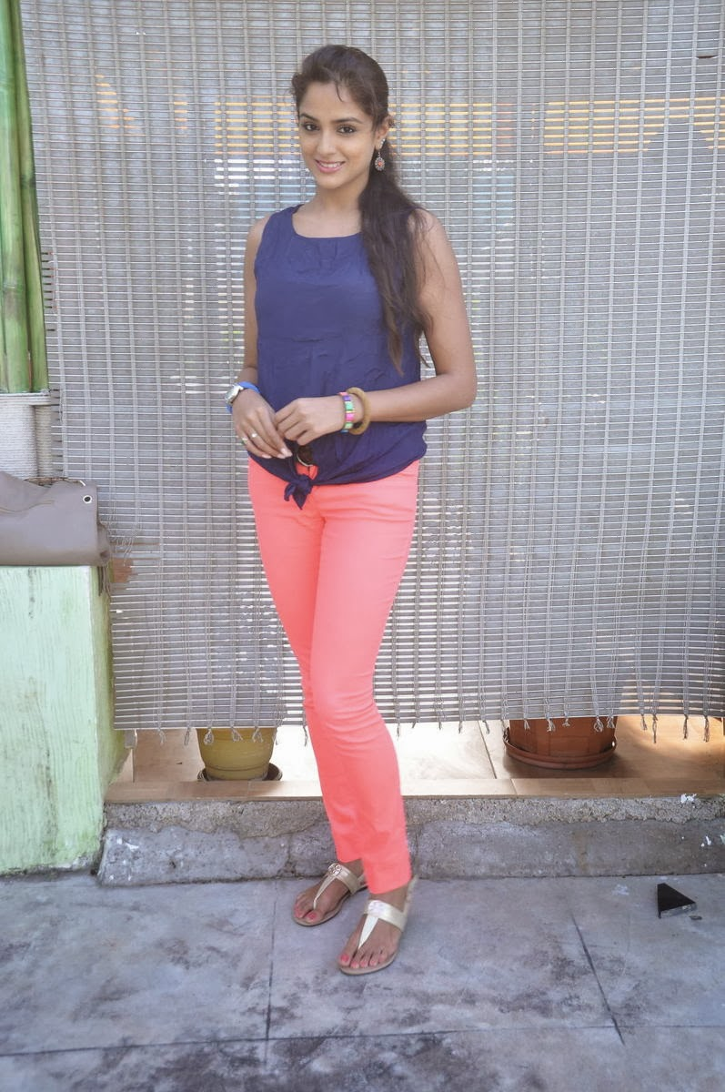 Charming Asmitha sood photos in jeans and top at an event